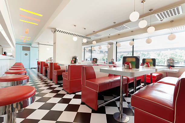 american diner restaurant style in black and white tiles and red booths